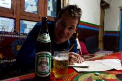 enjoying a local Lhasa beer..