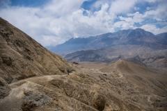 Raphael hiking in a mountain desert..